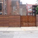 An outstanding ipe fence in a city environment